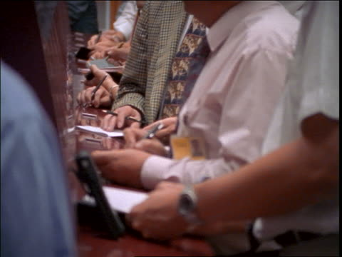 stockvideo's en b-roll-footage met close up pans of traders on floor of frankfurt stock exchange / germany - overhemd en stropdas