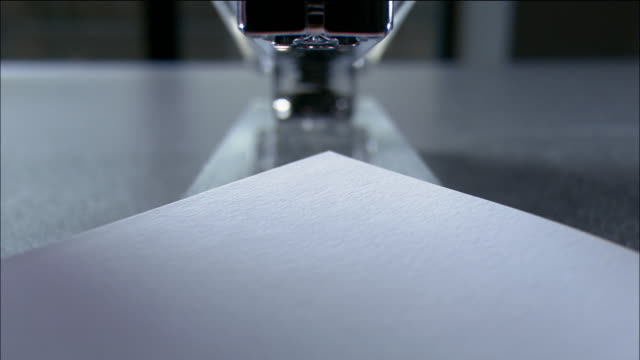 close up paper being stapled with clear stapler - ホッチキス点の映像素材/bロール