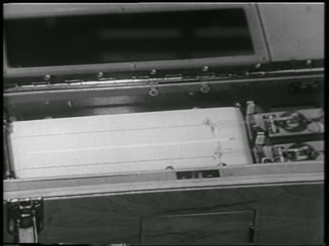 close up paper printout from machine monitoring reactions of monkey in rocket / newsreel - 1952 stock videos & royalty-free footage