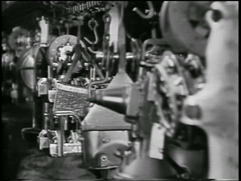 b/w 1932 close up parts hanging + moving on conveyor in ford car factory / industrial - 1932 stock-videos und b-roll-filmmaterial