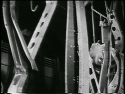 b/w 1932 close up parts moving on conveyor in ford car factory / industrial - 1932 stock videos & royalty-free footage