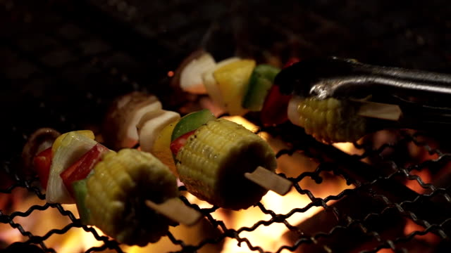 close up party of grilling delicious sweet corn - dinner party stock videos & royalty-free footage