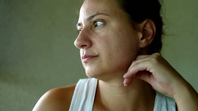 Close up pensive woman looking away