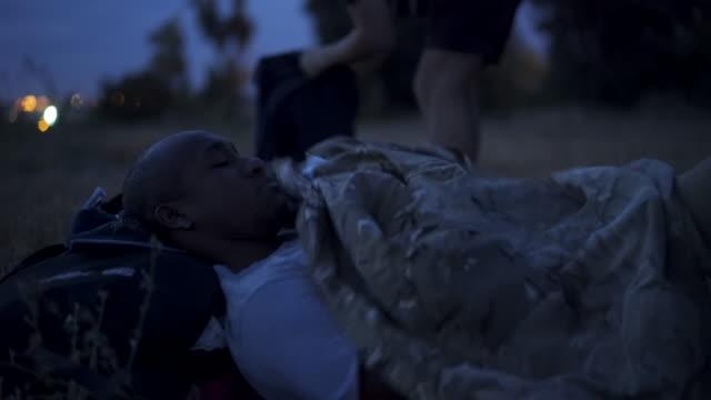 close up, people go to sleep in sleeping bag - 寝袋点の映像素材/bロール
