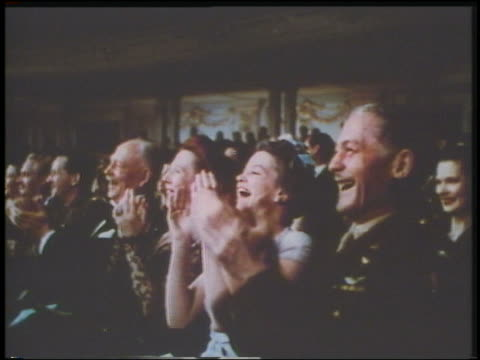 vidéos et rushes de 1943 close up people in audience in theater clapping / one man in military uniform - applaudir