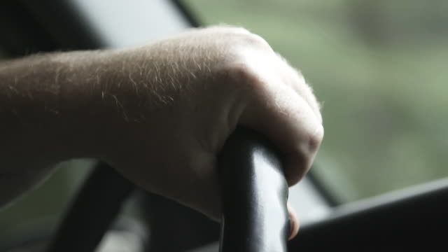 close up, person grabs steering wheel - steering wheel stock videos & royalty-free footage