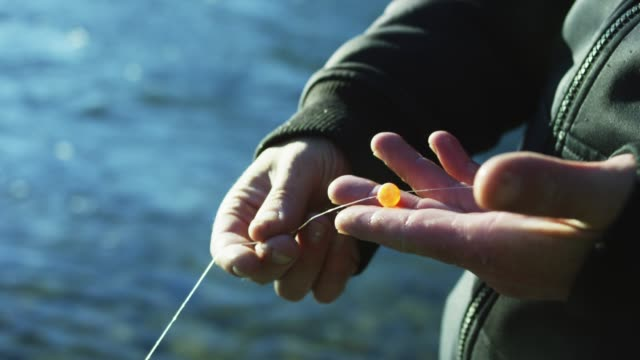 close up, person holds fishing line - fisherman stock videos & royalty-free footage
