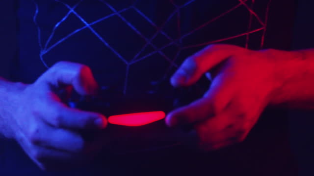 close up, person holds video game controller - gamer stock videos & royalty-free footage