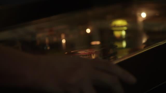 close up, person plays pinball machine - pinball machine stock videos & royalty-free footage