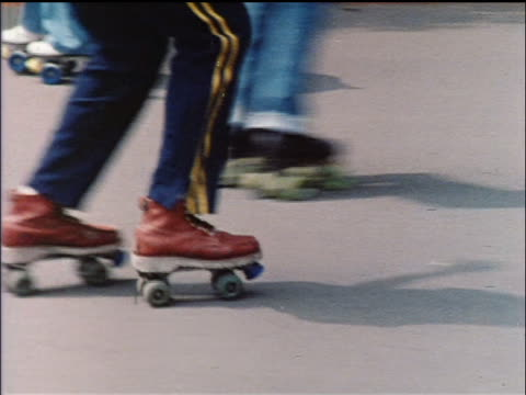 1978 close up person's legs on roller skates dancing outdoors / nyc / educational - 1978 stock videos and b-roll footage