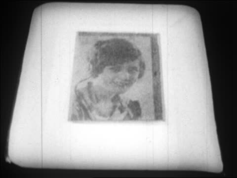 vidéos et rushes de b/w 1924 close up photograph of woman appearing in developer / photo sent by wire / newsreel - 1924