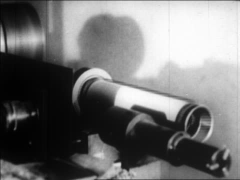 vidéos et rushes de b/w 1924 close up photograph on spinning cylinder in light scanner / sending photo by wire / newsreel - 1924