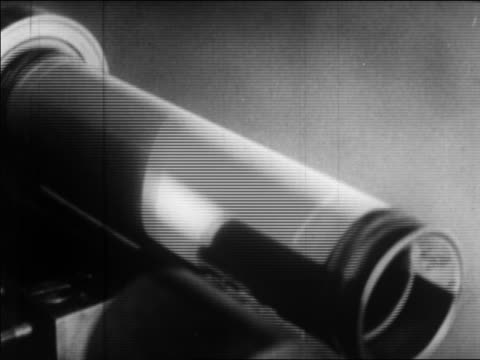 b/w 1924 close up photograph on spinning cylinder in light scanner / sending photo by wire / newsreel - 1924 stock videos & royalty-free footage