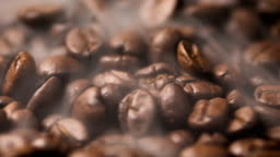Close up pile of Coffee beans rotate and roasting