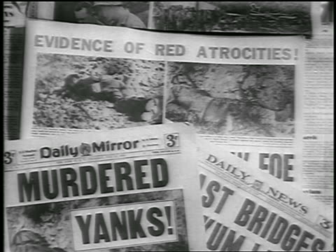 stockvideo's en b-roll-footage met b/w 1950 close up pile of newspapers with korean war headlines / newsreel - koreaanse oorlog