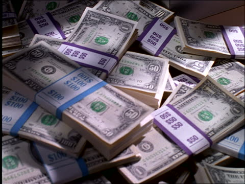 close up pan of pile of stacks of us money - large group of objects stock videos & royalty-free footage