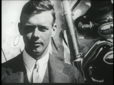 b/w 1927 close up pilot charles lindbergh in suit - only mid adult men stock videos & royalty-free footage