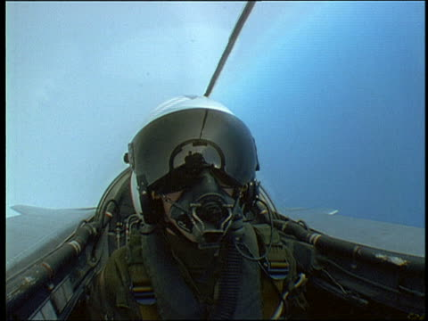 close up pilot in helmet with visor + oxygen mask in cockpit of mrca tornado rolling in blue sky - fighter stock videos and b-roll footage