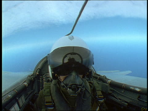 Close Up Pilot In Helmet With Visor Oxygen Mask In Cockpit Of Mrca