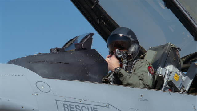close up pilot putting on helmet and closing cockpit of f-16/ denver, colorado - general dynamics f 16 falcon stock videos & royalty-free footage