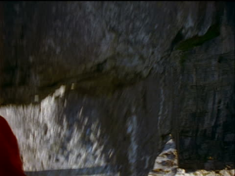 vidéos et rushes de close up point of view legs of base jumper jumping off + falling past cliff / sweden - caméra portable