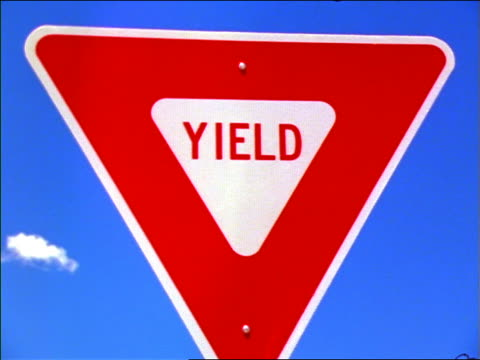 "close up point of view past ""Yield"" sign / New Mexico"