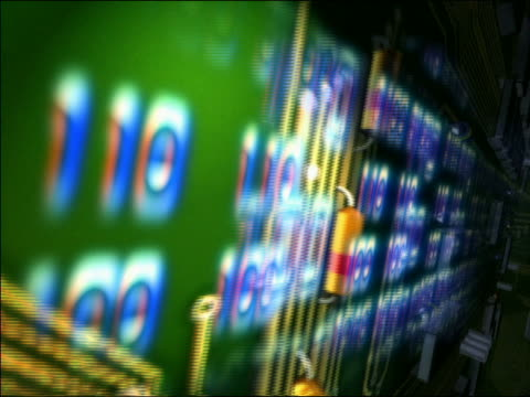 CGI close up point of view tracking shot over circuit board with blue binary numbers flashing across board