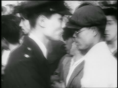 close up police pushing crowd of men at communist demonstration / japan / newsreel - 20 29 years stock videos & royalty-free footage