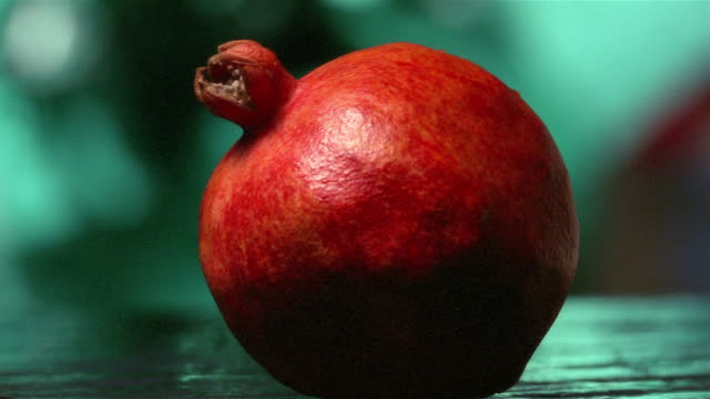 Close up pomegranate being cut in half