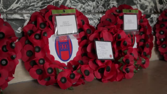 close up poppy wreaths flowers and flags on the grave of private stanislaw labno from nebraska at the cemetery in flanders where americans who died... - リース点の映像素材/bロール