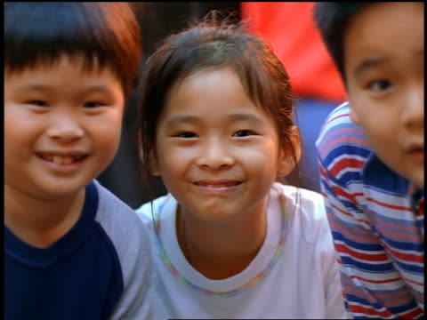 close up portrait 3 smiling asian children / night market, taipei, taiwan - female with group of males stock videos & royalty-free footage