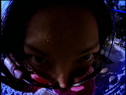 fisheye close up portrait asian woman wearing sunglasses making faces at camera in playground / miami - only mid adult women stock videos & royalty-free footage