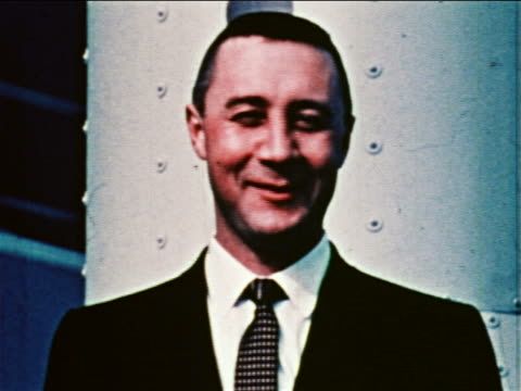 1959 close up portrait astronaut gus grissom in suit tie smiling outdoors / newsreel - only mid adult men stock videos & royalty-free footage