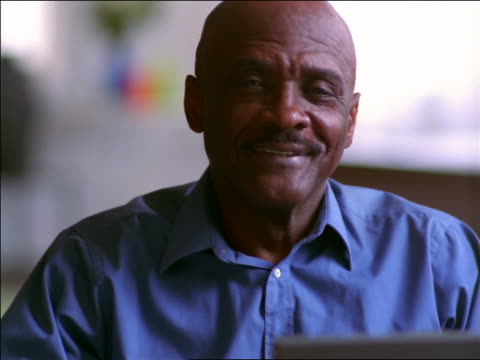close up portrait bald black man with mustache smiling - mature adult stock videos & royalty-free footage