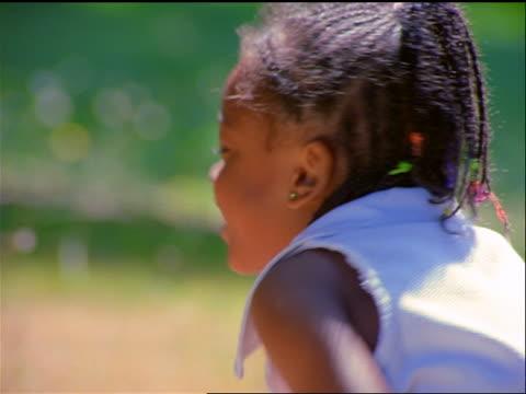vidéos et rushes de close up portrait black girl smiling at camera outdoors - seulement des petites filles
