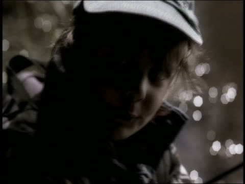 close up portrait boy wearing baseball cap / water in background - baseball cap stock videos & royalty-free footage