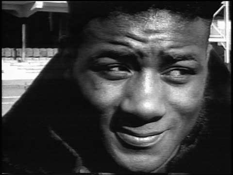 close up portrait floyd patterson's face outdoors / newsreel - 1956 stock-videos und b-roll-filmmaterial