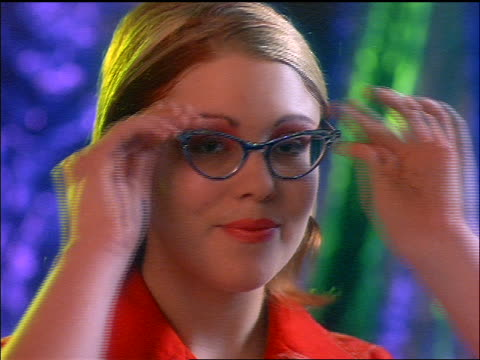 close up portrait gen x woman putting on cat-eye glasses + smiling - cat's eye glasses stock videos and b-roll footage