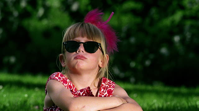 close up portrait girl wearing sunglasses looking into camera + pouting - sulking stock videos & royalty-free footage