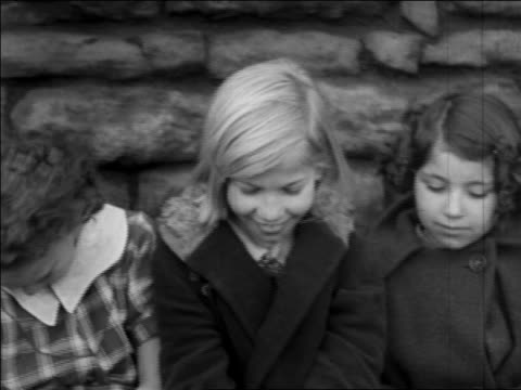 vidéos et rushes de b/w 1935 close up pan portrait group of girls sitting by coke ovens / pennsylvania / newsreel - 1935