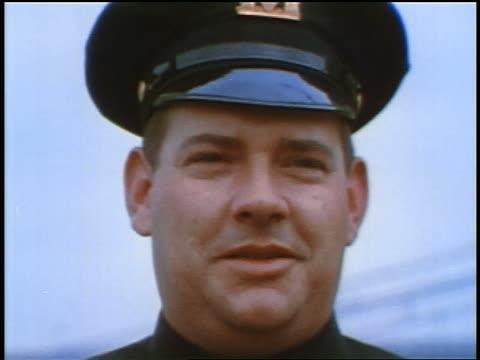 vídeos de stock, filmes e b-roll de 1957 close up portrait male policeman in hat looking at camera - força policial