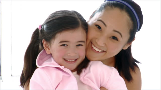 close up portrait mother hugging daughter/ brooklyn, new york - mixed race person stock videos & royalty-free footage