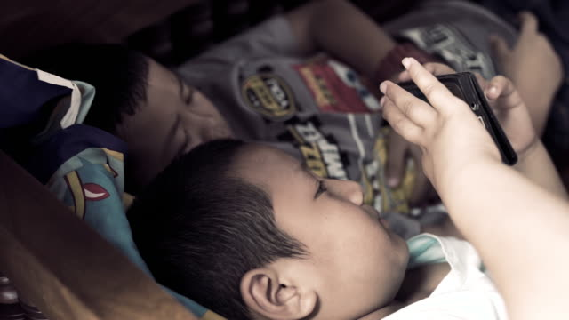 close up portrait of a boy playing with digital tablet - brother stock videos & royalty-free footage