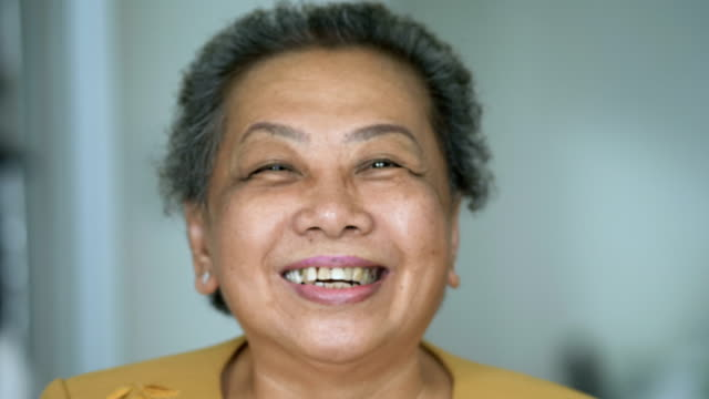 close up portrait of a happy senior woman smiling. handheld shot - independence stock videos & royalty-free footage