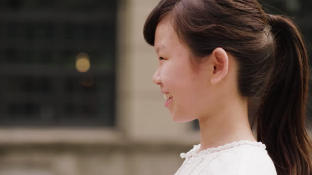 close up portrait of a young girl in a public park in taipei - taipei stock videos & royalty-free footage