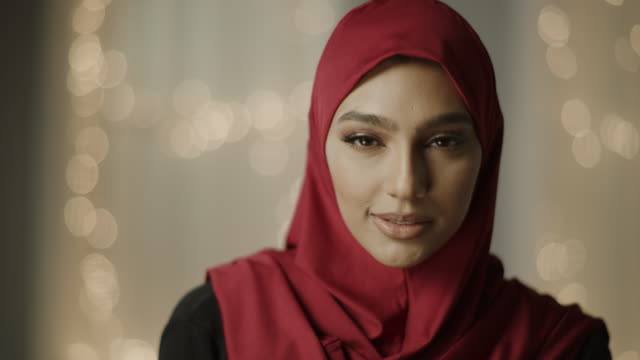 close up portrait of beautiful smiling woman wearing hijab / cedar hills, utah, united states - video portrait stock videos & royalty-free footage