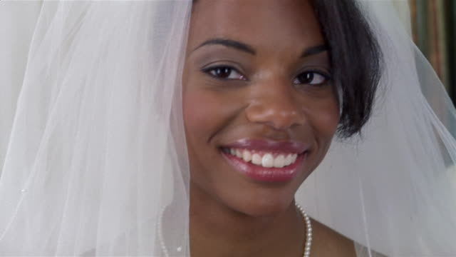 Close up portrait of bride smiling at camera