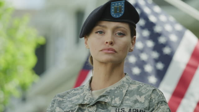 stockvideo's en b-roll-footage met close up portrait of confident army soldier near american flag / lehi, utah, united states - army
