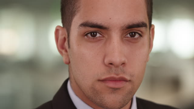 close up portrait of confident latino businessman in office looking at camera - neckwear stock videos and b-roll footage