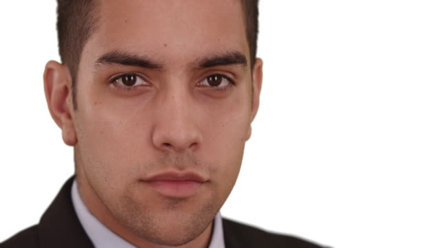 close up portrait of confident latino businessman on white background - neckwear stock videos and b-roll footage